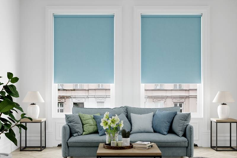 Splash blue blackout roller blinds in big living room windows