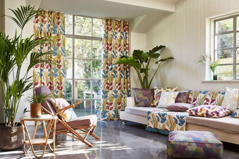 Colourful curtains with tropical pattern in a large living room French door