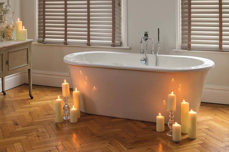 Taped faux wood blind in a bathroom with candles