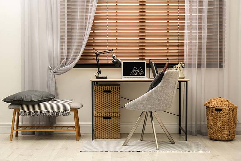 Real medium wood blind in a home office