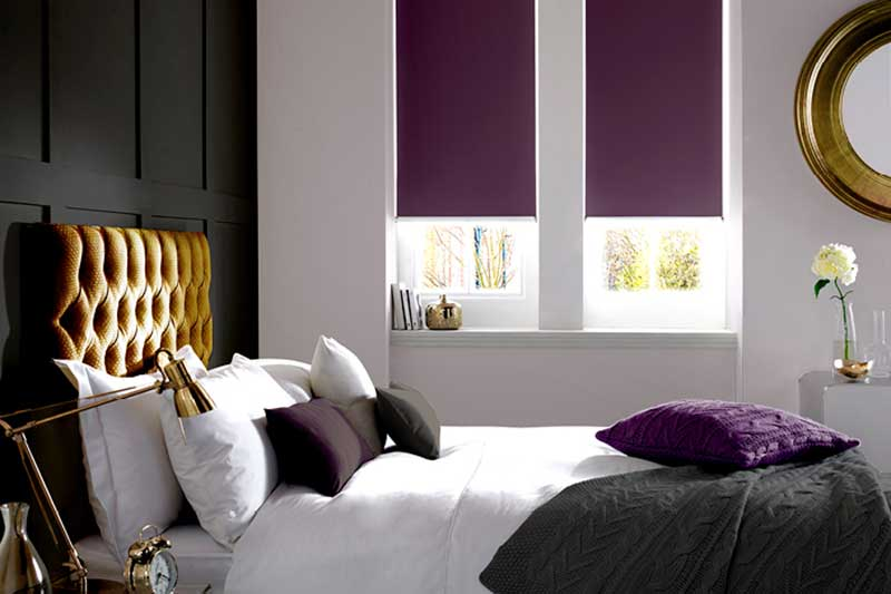 Purple blackout Roller Blind in a bedroom