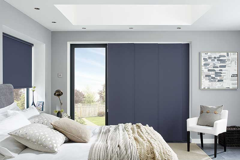 Blue Panel Blind in a Bedroom