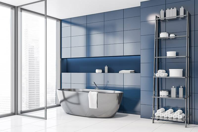 Bathroom with blue tiled wall