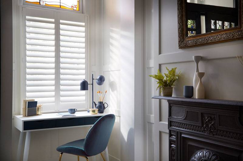 White Café Style shutters in living room window