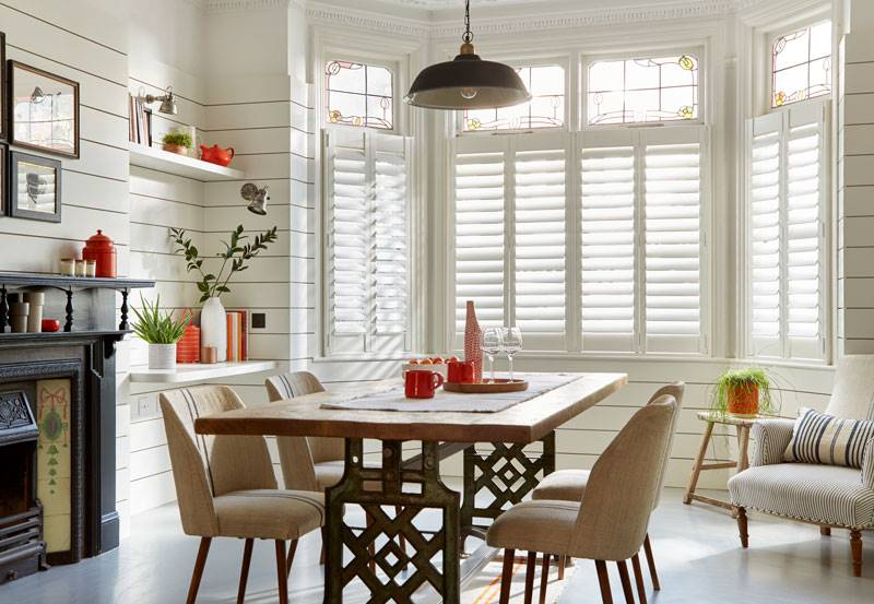Café style shutters in a big kitchen bay window