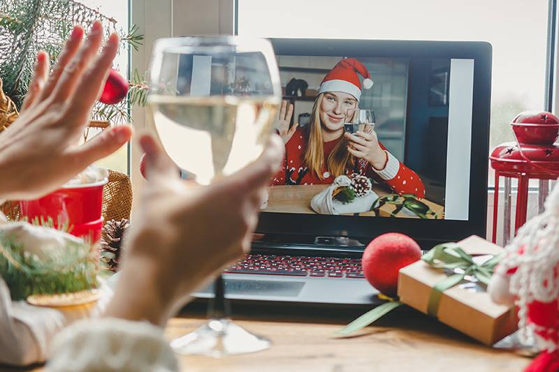 Two ladies celebrating Christmas over a video call