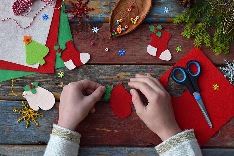 A child making Christmas cards at home