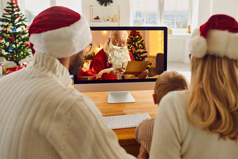 A family with a young child virtually visiting father Christmas