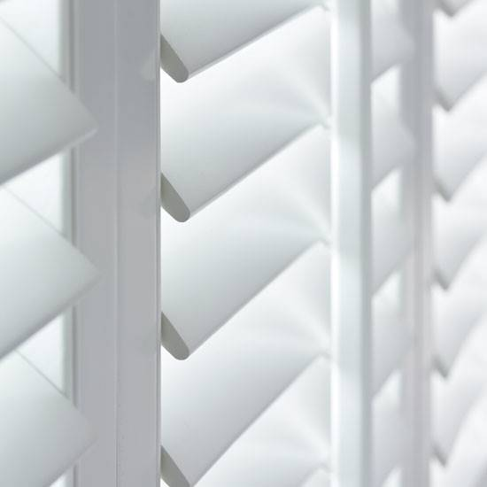 Close up of white window shutter louvres