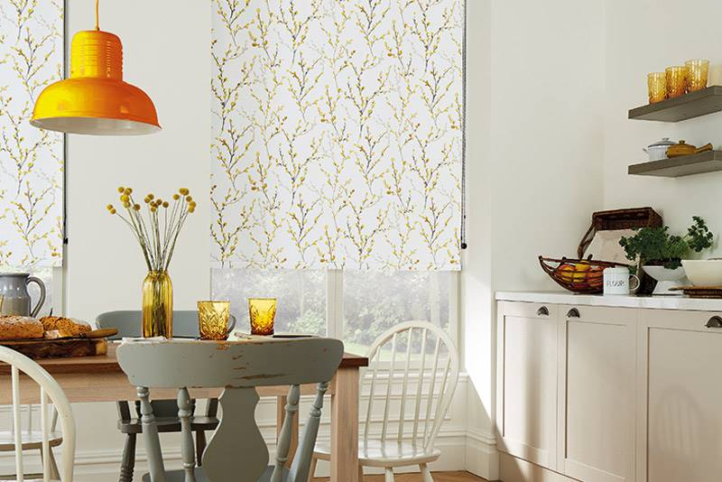 Willow Blackout Brazen Yellow roller blind in big kitchen windows