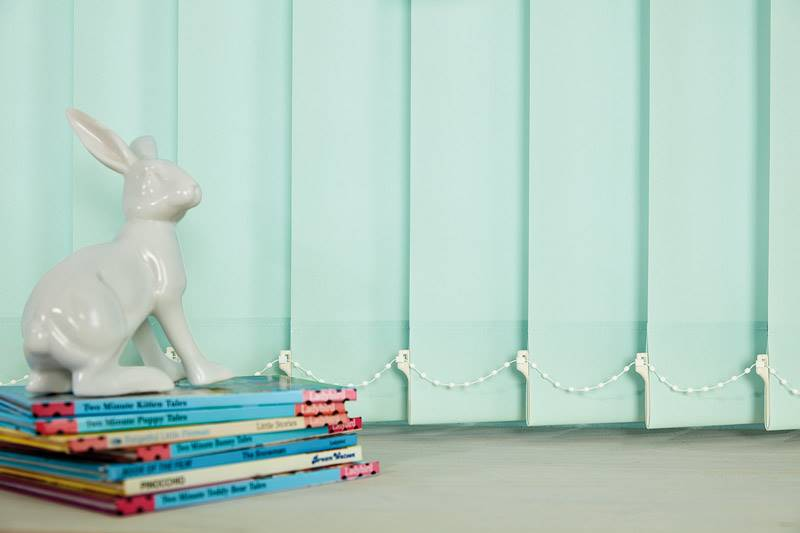 Close up of vertical blind slats in a nursery