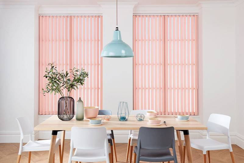 Pink vertical blinds in big kitchen windows