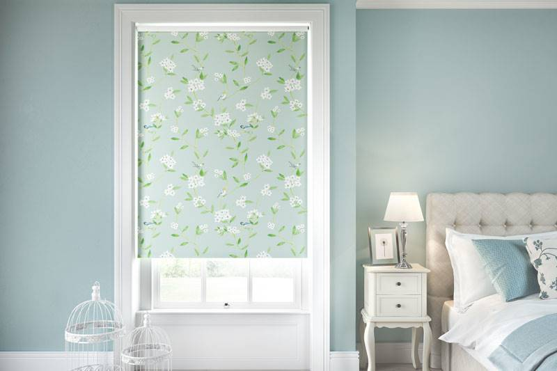 Blue floral blackout roller blind in a large bedroom window
