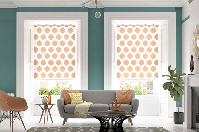 Pattered orange roller blind in large living room windows