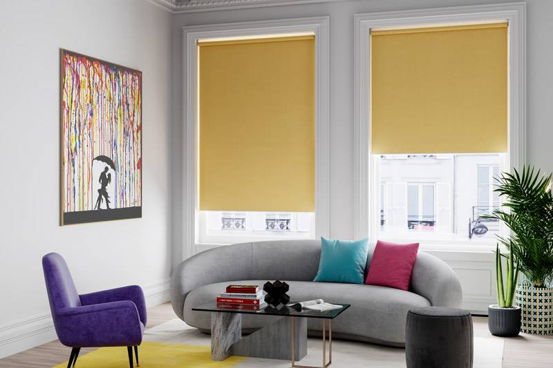 Yellow plain roller blind in large living room windows