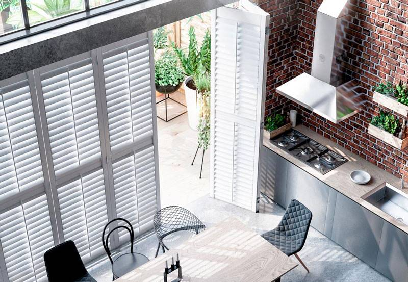 White faux wood full heigh shutters in kitchen French doors