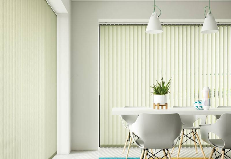 White plain vertical blinds in big kitchen windows