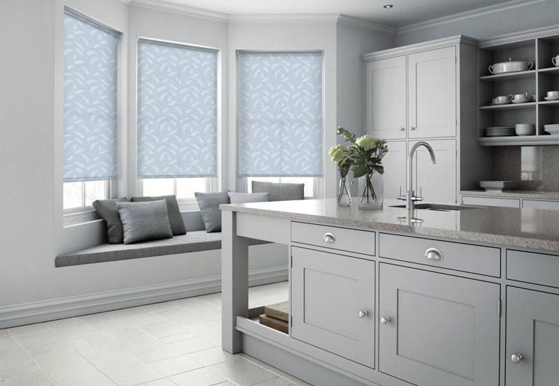Blue patterned roller blind in a kitchen bay window