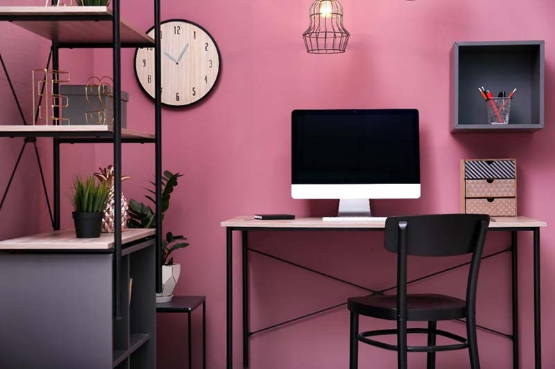Hot pink home office with grey shelving