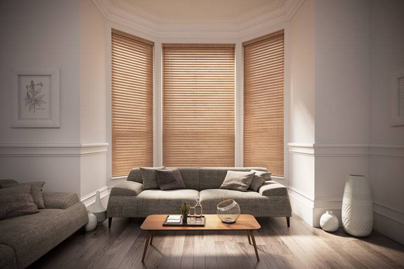 Light Oak wooden blinds in a large living room bay window