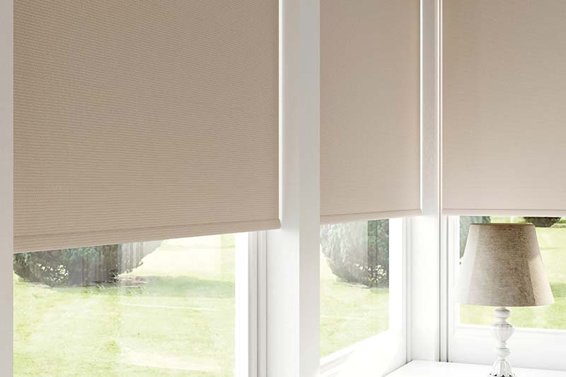 Blackout cream roller blinds in the conservatory
