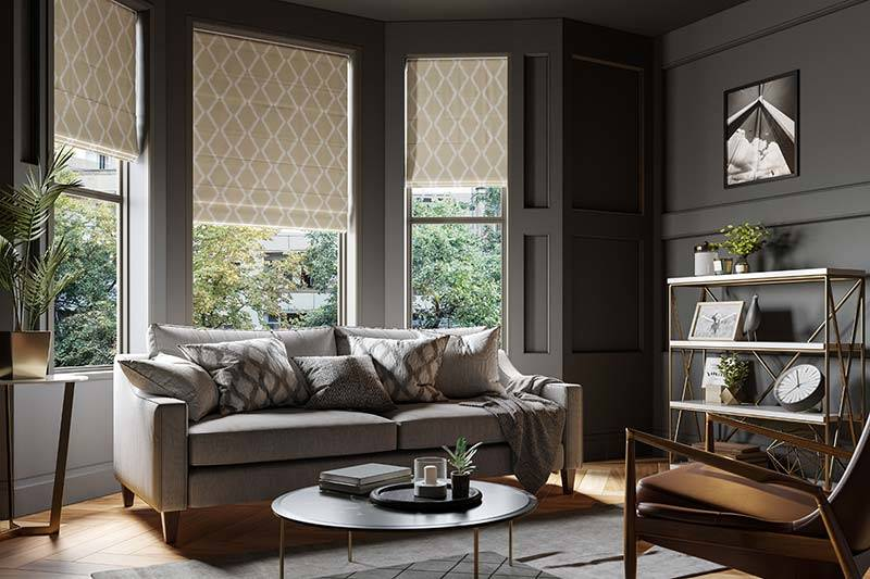 Patterned roman blinds in a big bay living room window