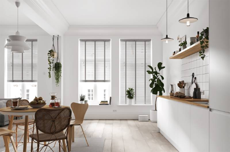 Taped Faux wood blinds in big kitchen windows