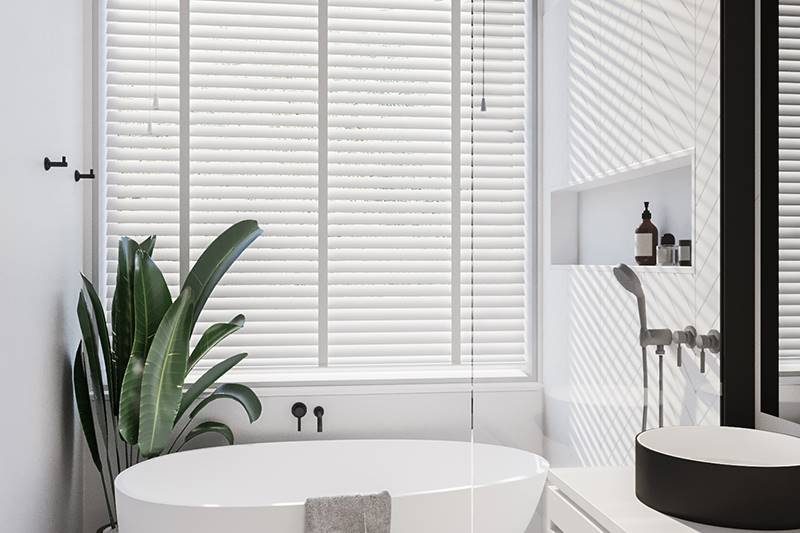 Taped faux wood blinds in a big bathroom window