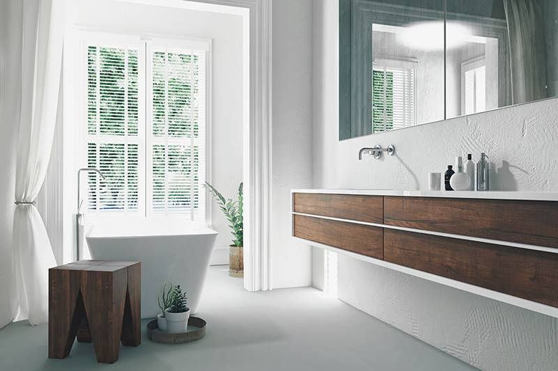 White faux wood blind in a large bathroom window