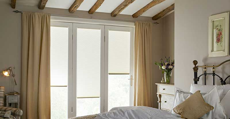 white perfect fit pleated blinds in bedroom