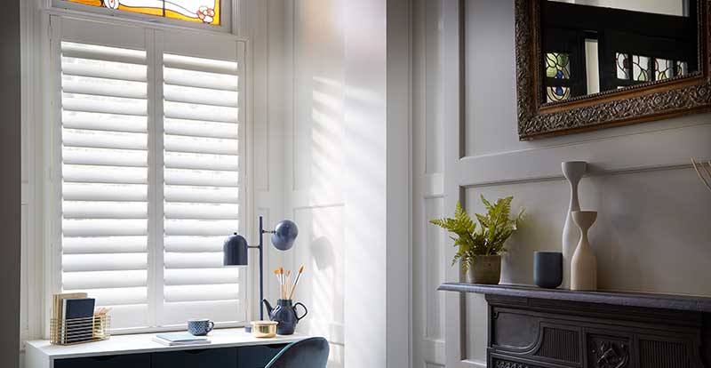 white shutters in home office