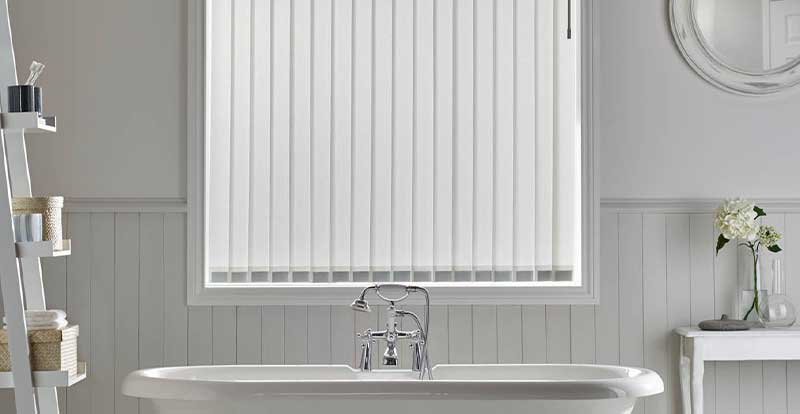 White replacement vertical blind slats in bathroom