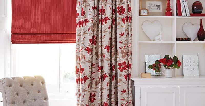 red floral curtains paired with blackout roman blind in living room
