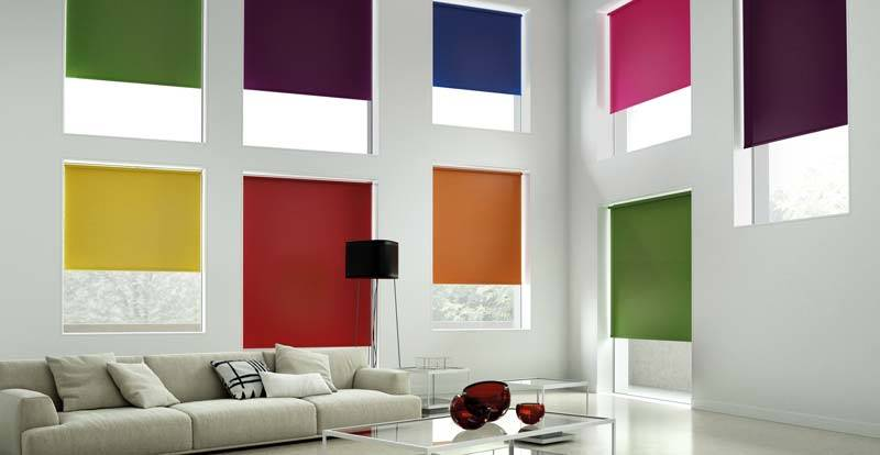 blackout roller blinds in various colours in the living room