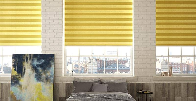 yellow electric roller blinds in bedroom