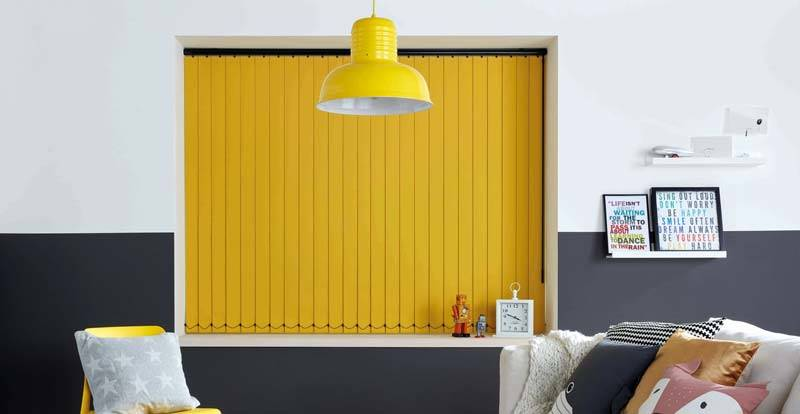 yellow vertical blind in bedroom