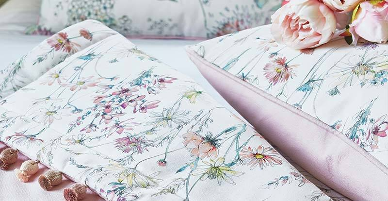Close up of a floral bedding and cushions
