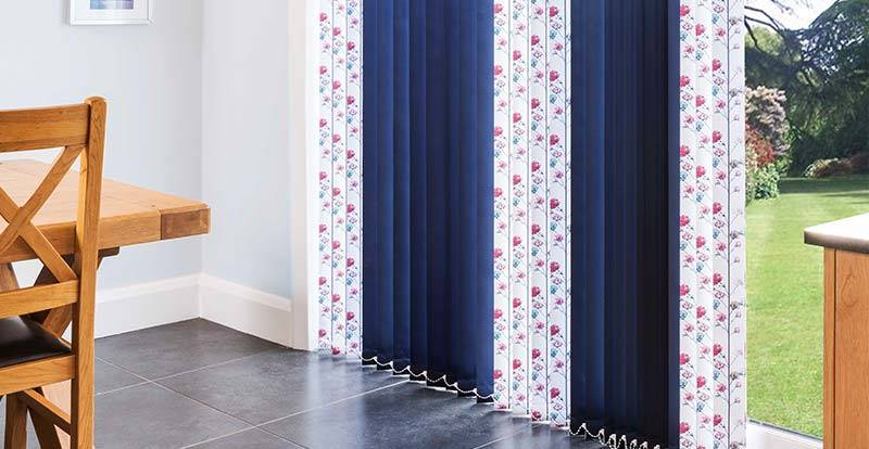 Close up of mixed blue and floral vertical replacement slats in a patio door