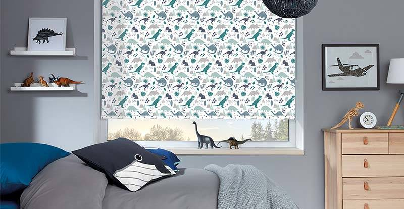 Children's room with a fun patterned roller blind and wall art work