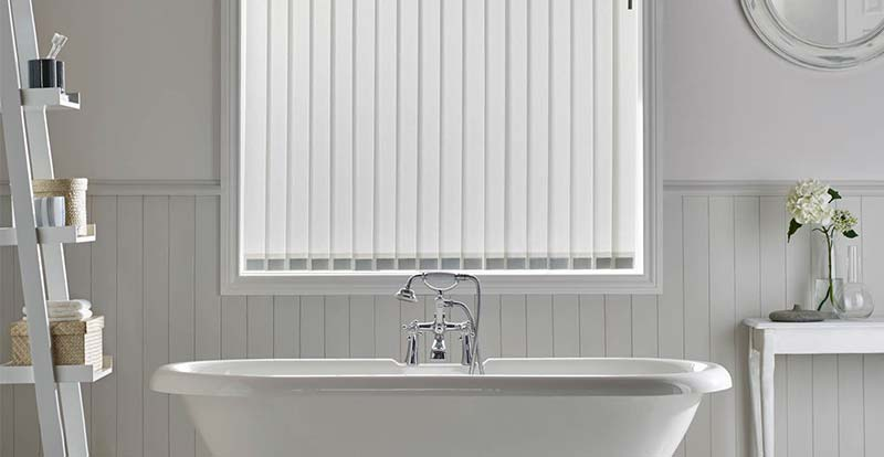 Bathroom with plain white vertical blinds