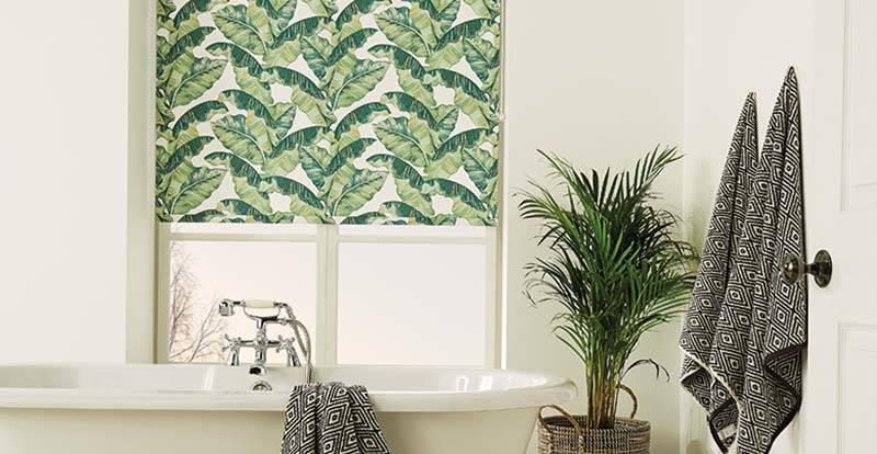 Tropical patterned blackout roller blinds in a bathroom