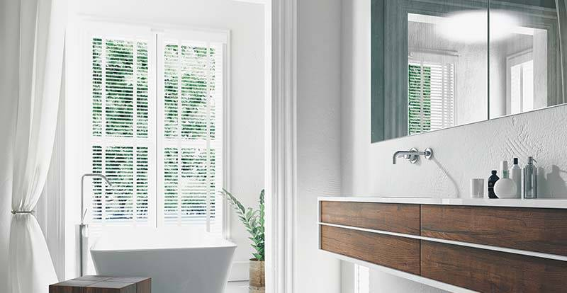 Light wooden taped blinds in a bathroom