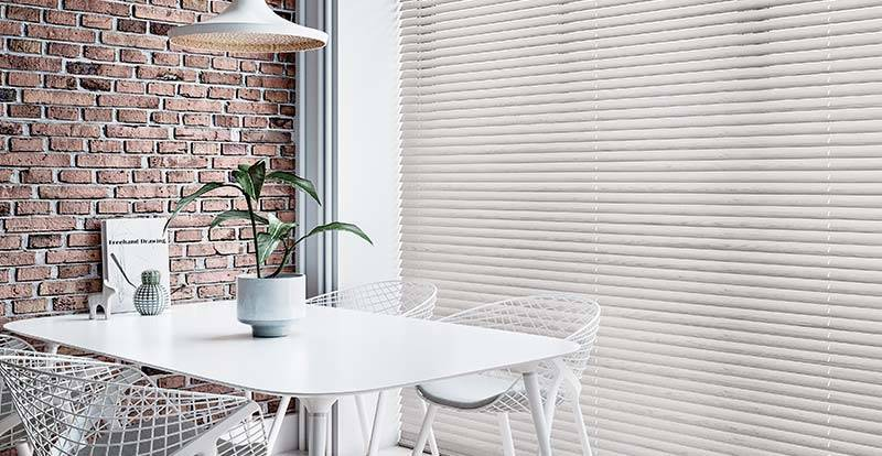 Grey wooden blind in a full height dining room window