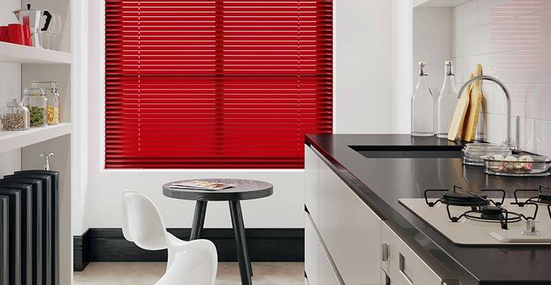 Red venetian blind in a large kitchen window