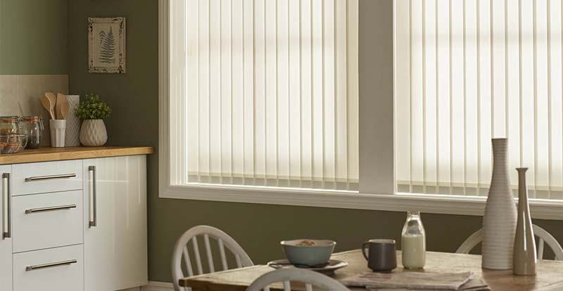 White vertical blinds in a kitchen