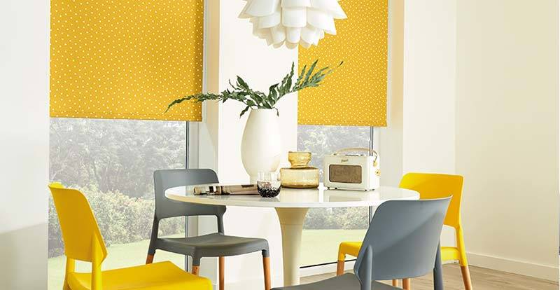 Yellow roller blind in a dining room