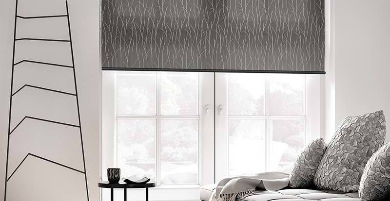 Grey roller blind in a big living room window