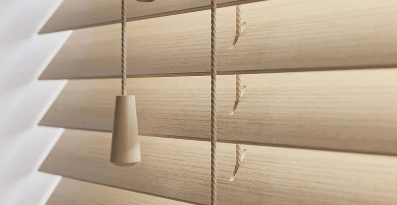 Close up of a light wood blind