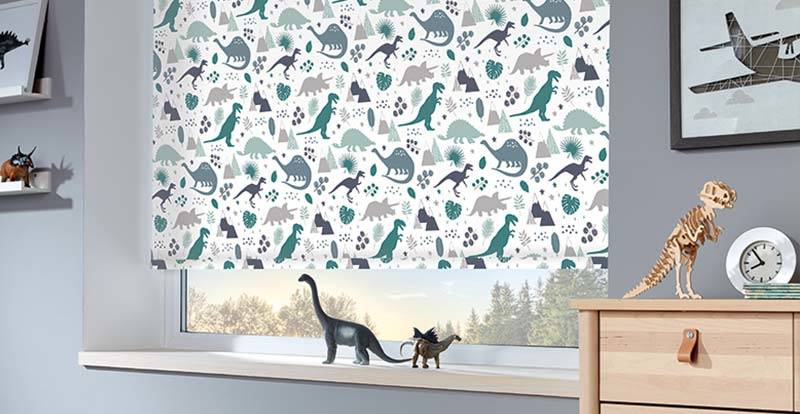 Close up of a patterned roller blind in a children's room
