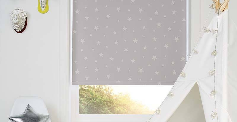Close up of a patterned roller blind with stars in children's room